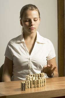 Woman With Dominos Stock Photo