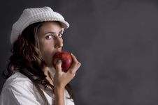 Free Beautiful Young Woman Eating Red Apple Stock Photos - 6895793