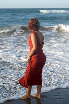 Alone Woman Walking In The Seaside Stock Image