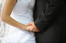 Free Hands Of The Groom And The Bride Stock Photography - 6896172