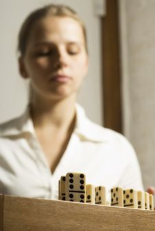 Woman With Dominos Royalty Free Stock Photo