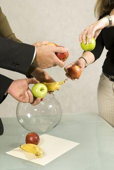 Team Arranging Fruit In Bowl Stock Photos