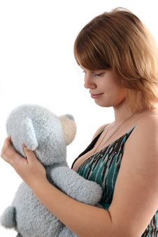The Young Girl Holds A Teddy Bear Stock Photo