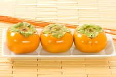Free Persimmons Head On View Stock Image - 6898901
