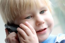 Child Speaks On The Telephone Royalty Free Stock Images