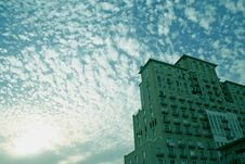 Cloud Formation And Silhouetted Skyscraper Royalty Free Stock Photos