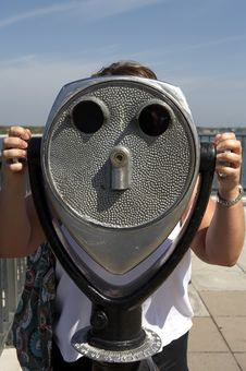 Woman Looking Through A Coin Operated Binoculars Stock Photography