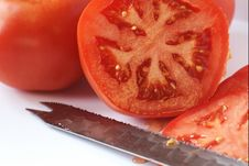 Free Sliced Fresh Tomato And Knife Stock Image - 699921