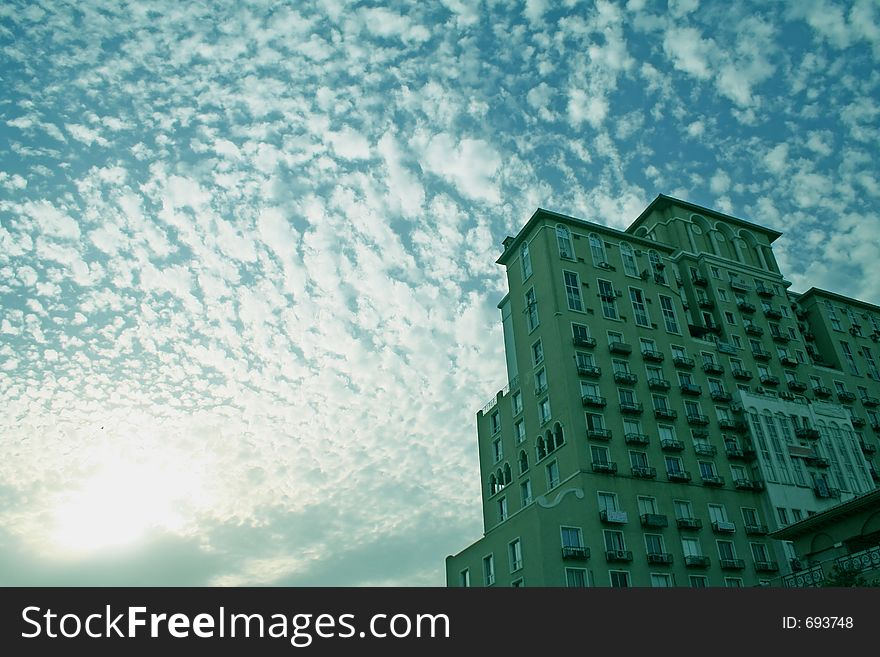 Cloud formation and silhouetted skyscraper