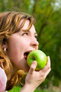 Free Pretty Woman Eating Green Apple Stock Photo - 6909520