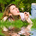 Free Girl Blowing On The Dandelion Royalty Free Stock Photo - 6909635