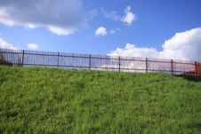 Free Fence On The Grassy Hill. Stock Images - 6900964