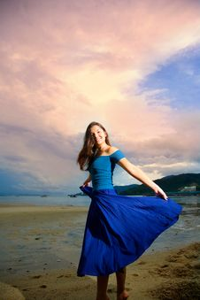 Free Young Eurasian Woman At The Sunset Beach Stock Images - 6901014