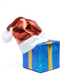 Santa S Red Hat And Gift Box Royalty Free Stock Photo