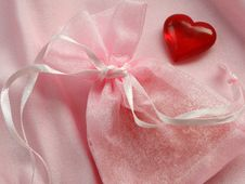 Small Gift In Rosy Bag And Red Heart Royalty Free Stock Photo
