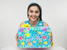 Free Asian Girl With A Gift Box Royalty Free Stock Photo - 6904195