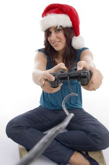 Young Woman With Remote And Christmas Hat Royalty Free Stock Images