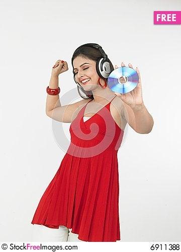 Free Female Enjoying Music Royalty Free Stock Photos - 6911388