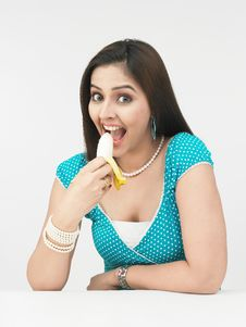 Free Woman Eating A Yellow Banana Royalty Free Stock Images - 6910789