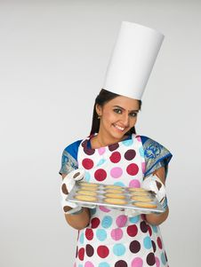 Free Asian Female Baker With Cookies Stock Photography - 6910932