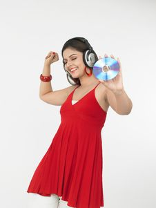 Free Female Enjoying Music Royalty Free Stock Photos - 6911388