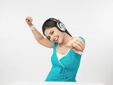 Free Asian Female Enjoying Music Stock Images - 6911404