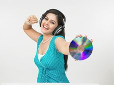Free Asian Female Grooving To The Music Royalty Free Stock Images - 6911409