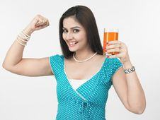 Free Lady Drinking Orange Juice Royalty Free Stock Photography - 6911417
