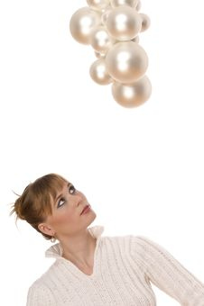 Free Young Woman Watching Up Christmas Balls Stock Photos - 6912183