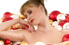 Free Woman Sleeping In Bathtub Full Of Christmas Balls Stock Images - 6912204