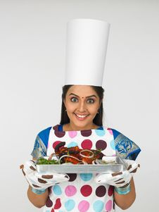 Chef With Her Baked Chicken Royalty Free Stock Image