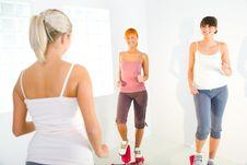 Free Women Exercising On Stepping Machine Royalty Free Stock Image - 6915856
