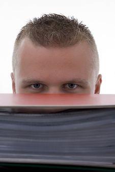 Free Man Stashed  Behind Folders Stock Photos - 6916343