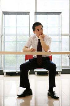 Young Businessman Sit In Office Royalty Free Stock Photography