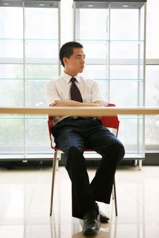Young Businessman Sit In Office Royalty Free Stock Image