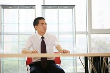 Young Businessman Sit In Office Stock Photos