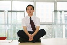 Young Businessman Sit In Office Stock Photo