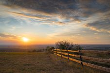Meadow With Wooden Fence Royalty Free Stock Photo