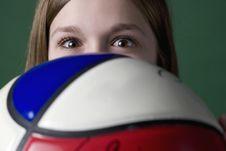 Free Teen Girl Peeking Over Her Soccer Ball Stock Image - 6920051