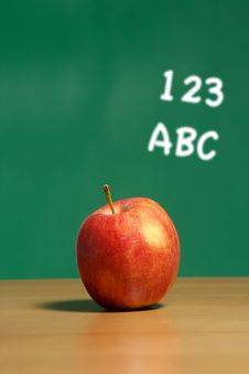 Free An Apple On A Desk In A Classroom Royalty Free Stock Photography - 6920217