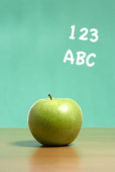 Free An Apple On A Desk In A Classroom Royalty Free Stock Image - 6920366