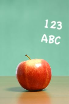 Free An Apple On A Desk In A Classroom Royalty Free Stock Photos - 6920568