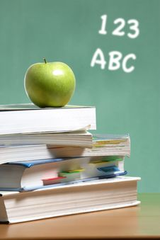 Free Apple On Stack Of Books In Classroom Royalty Free Stock Photo - 6920835