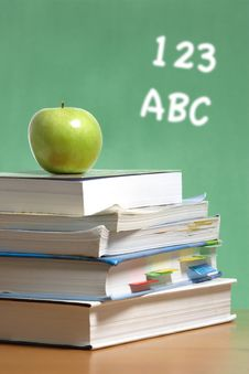 Free Apple On Stack Of Books In Classroom Royalty Free Stock Photos - 6920848