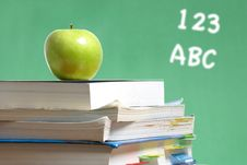 Free Apple On Stack Of Books In Classroom Stock Photography - 6920902