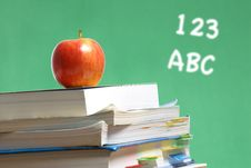 Free Apple On Stack Of Books In Classroom Royalty Free Stock Image - 6920946
