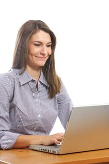 Free A Business Woman On Her Laptop At A Desk Stock Photo - 6921000