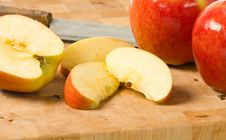 Free Cut Apples On Cutting Board Stock Image - 6921611