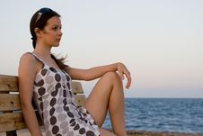 Free Woman Sitting On A Bench Royalty Free Stock Photo - 6922415