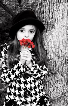 Girl By Tree With Flower Royalty Free Stock Photography